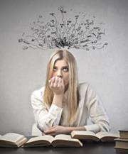 A woman surrounded by books and thinking