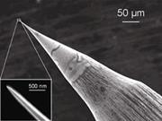 Figure 2 - Image of an STM tip under both 1000x and 100,000x magnification