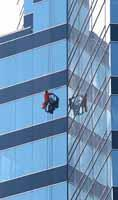 A window cleaner on a skyscraper