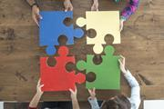 Working together joining large jigsaw pieces