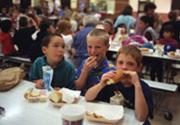 Children eating packed lunch