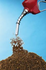 Coffee grounds being poured from a fuel pump