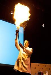Blowing flames in a Kitchen chemistry demonstration