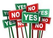 Signs in green and red saying yes and no on