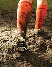 Muddy football socks