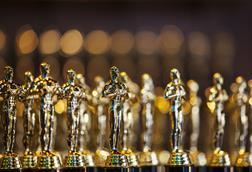 An image showing golden statues representing academy awards