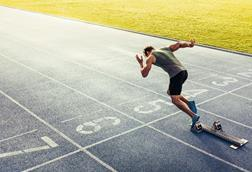 Man sprinting out of the blocks on a track