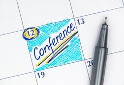 A calendar with a conference scheduled