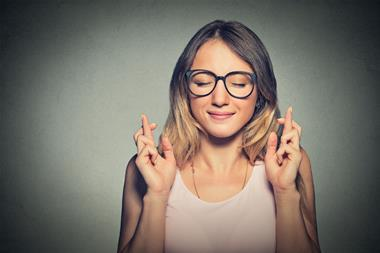 Woman crossing her fingers for a good exam result