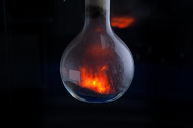 Round bottomed flask containing ammonium dichromate as it decomposes