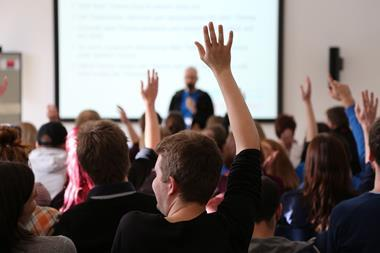 Teachers in a lecture theatre at an education conference