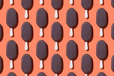 An image showing repeating chocolate ice cream bars on sticks against an orange background