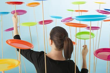 Woman literally trying to keep lots of plates spinning