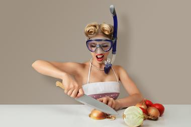 Wearing a mask and snorkel to chop onions