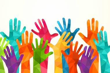 Colourful hands raised in the air