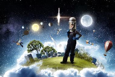 Child wearing helmet and astronaut costume