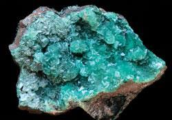 Smithsonite (also known as zinc spar) is usually light green in colour