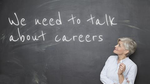 A picture showing a teacher looking at a blackboard with 'We need to talk about careers' written on it