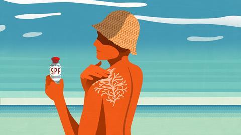 An image showing a person on the beach applying sunscreen on their skin, which looks like a piece of coral on their back