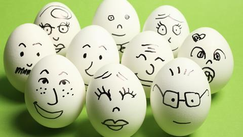 10 eggshells with faces drawn on them