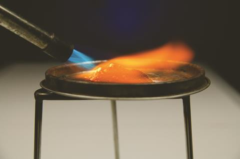 Bunsen burner lighting a pile of zinc and copper oxide