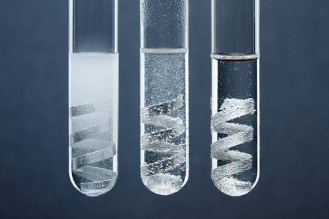 An image showing three test tubes, each containing magnesium strips in hydrochloric acid solutions of different concentrations