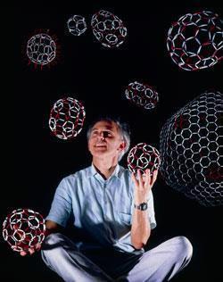 Harry Kroto holding closed buckyball cages