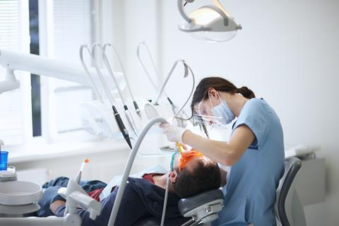 An image showing a dentist at work