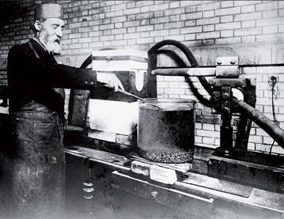 Henri Moissan working in his laboratory