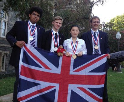 The 2012 UK Chemistry Olympiad team: Callum Bungey, Thomas Spence, Paddington Bear (mascot), Ella Mi and Walter Kähm