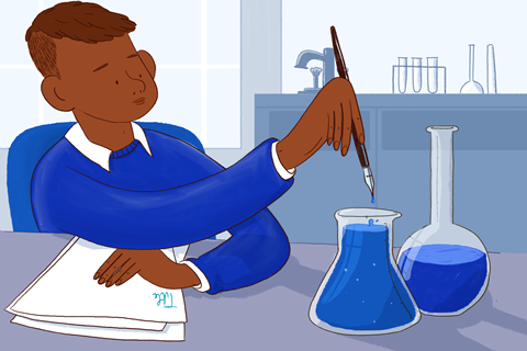 An image showing a male student dipping his pen into a conical flask containing ink