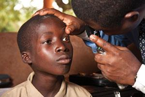 Medical personnel screen students in Togo for signs of river blindness