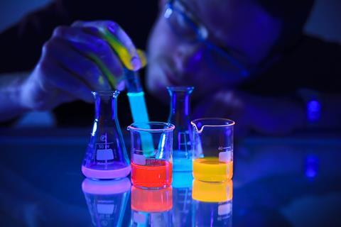 An image showing beakers containing the chemoluminescent compound luminol in beakers