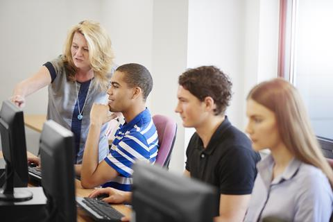 Students and teacher using computers