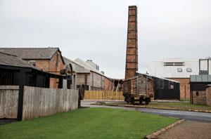The restored blacksmiths, salt wagon and pump house