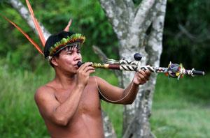 A South American Indian using a blowpipe