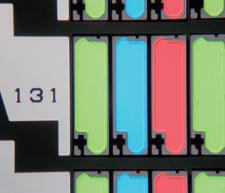Coloured scanning electron micrograph from a laptop computer's liquid crystal display. It shows the grid (black) and the subpixels (coloured rectangles)