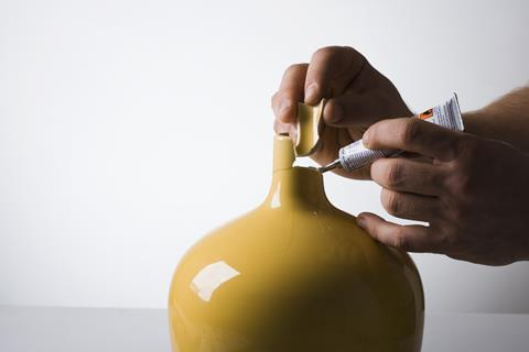 An image showing super glue being used to mend a vase