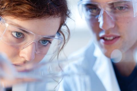 Close-up of scientists observing a reaction