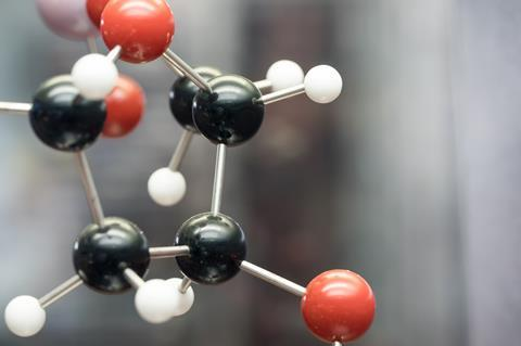 A close up of a molecule showing carbon, oxygen and hydrogen