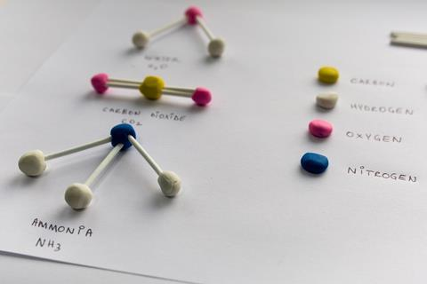 A picture showing molecular models built out of plasticine and cotton buds