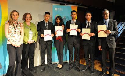 The winning students from Cumberland School receive their certificates from representatives from the British Council and Rolls-Royce