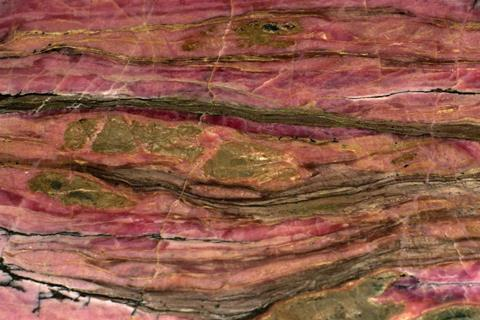 Pink, striated rhodonite mineral