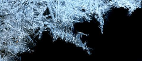 Ice crystals forming with a black background, right-hand corner