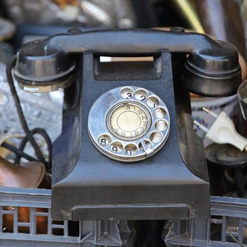 An image showing an old Bakelite telephone