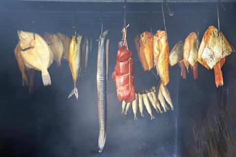 A range of foods hanging in a smokehouse