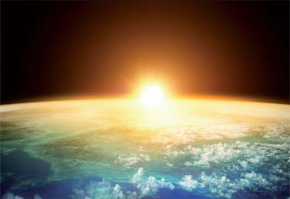 The sun setting over the earth