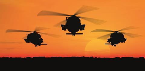 helicopters flying against the sunset