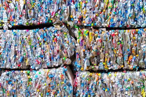 Bales of compacted bottles
