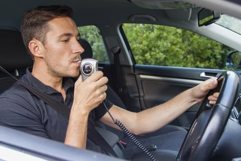 Man taking a breathalyzer test